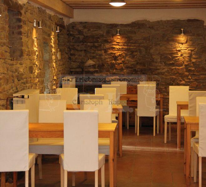 Seminarhaus Much Innenraum mit Tischen